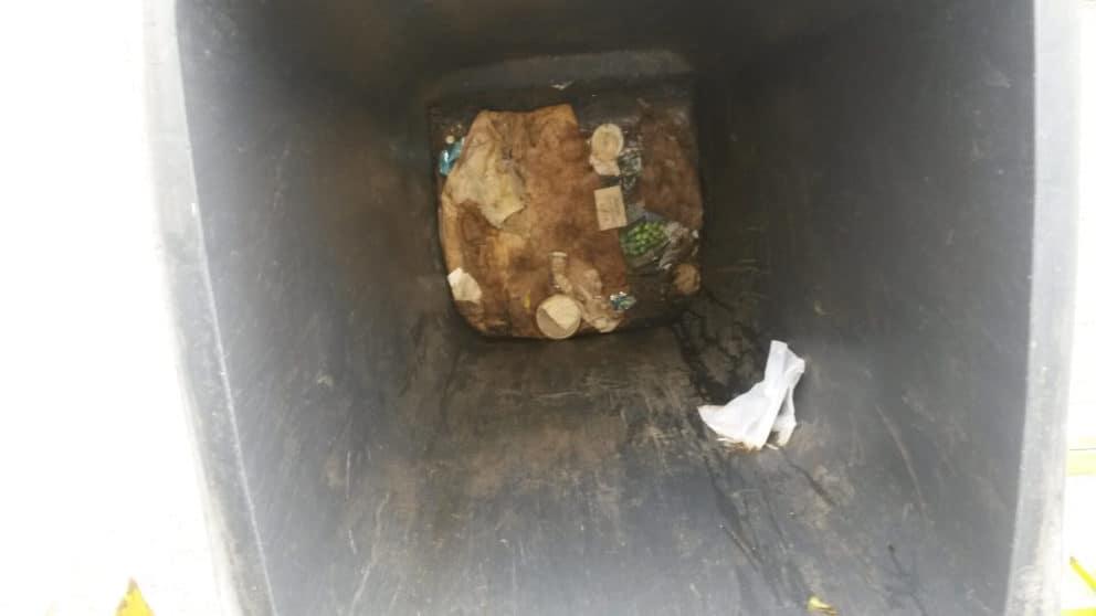 a dirty wheelie bin